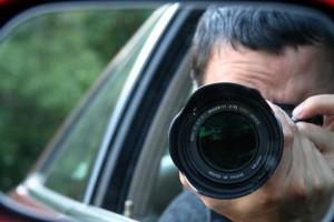 Paparazzi - Man taking photo from car